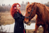 Young redhead girl and horse