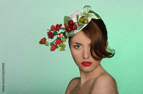 Woman in hat with berry decoration