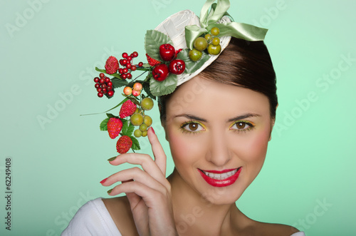 Woman in elegant hat with berry decoration