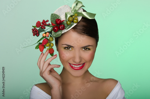 Woman in elegant hat with strawberries