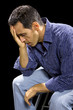 depressed or stressed man in black background