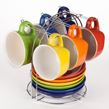 set of multicolored teacups and saucers on stand