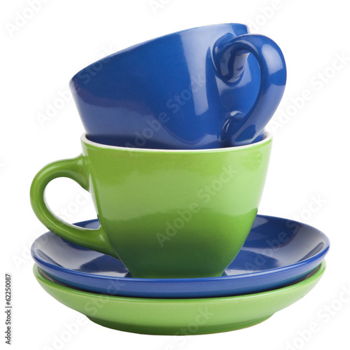 Set of green and blue cups and saucers, isolated on white.