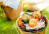 Stuffed savory sweet peppers grilling on foil