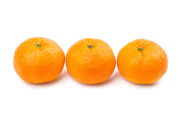 Close-up of three sweet mandarins