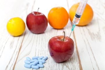 Injection into red apple
