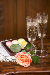 Two glasses of sparkling wine or champagne with small colorful