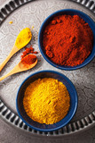 spices in bowls: curry and paprika powder