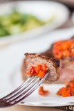 Grilled beef steak, slice on fork with tomato salsa sauce