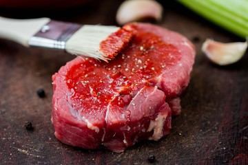 Raw beef steak, greased tomato sauce brush, cooking delicious
