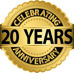 Celebrating 20 years anniversary golden label with ribbon, vecto