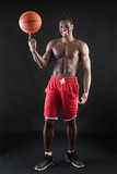 Portrait of smiling young black man shirtless with basket ball a