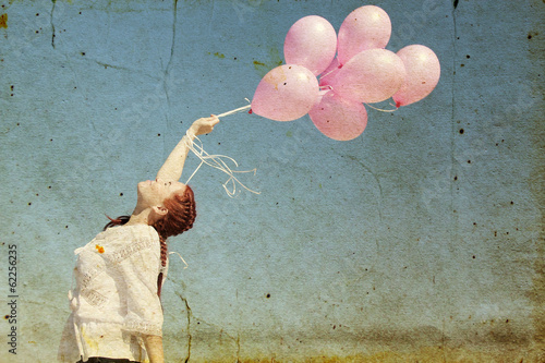 beautiful woman with colorful balloons outside. Photo in old ima