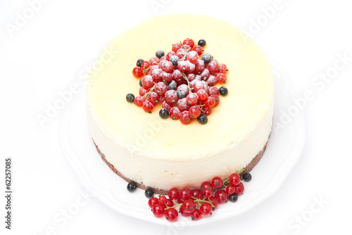 cheesecake with red and black currants, isolated