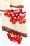 piece of cheesecake decorated with red and black currant