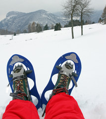 blue snow shoes for walking on fresh snow mountain with red snow