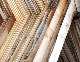 sturdy wooden planks stacked to be dried in the sun
