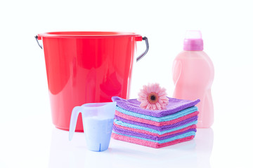 laudry detergents and clean towels with a flower