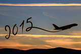 New year 2015 drawing by airplane on the air at sunset