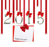 2015 number and Christmas greeting card hanging on red ribbons