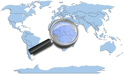 World map blue continents with Africa magnified by loupe