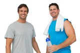 Portrait of two fit young men with water bottle and towel
