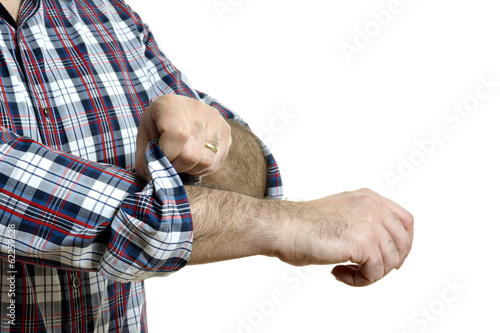 Man rolls up sleeves