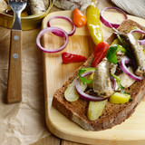 Sprat sandwich with pickled vegetables