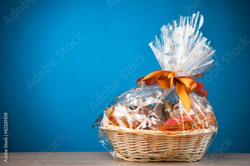 canvas print picture gift basket against blue background