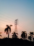 view of the high voltage electricity tower at dusk