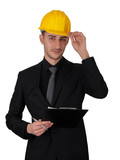 Man with Hard Hat Holding Clipboard