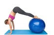 Side view of a fit woman stretching on fitness ball