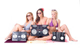 Three sexy girl posing with audio equipment