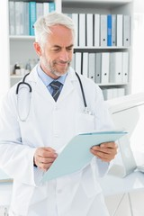Doctor looking at a folder in the medical office