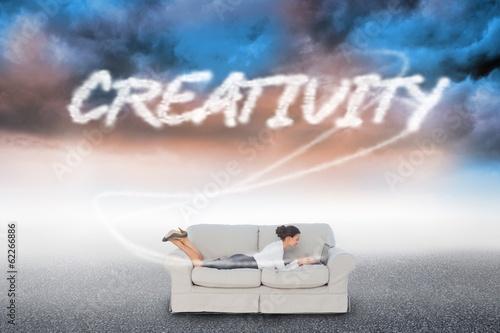 Creativity  against cloudy landscape background