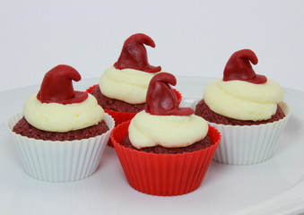 Selection of red velvet cupcakes with cream cheese frosting