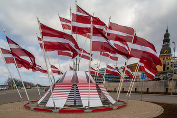 Flags of the Republic of Latvia in a festive decoration.