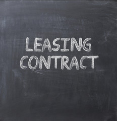 leasing contract text on a blackboard