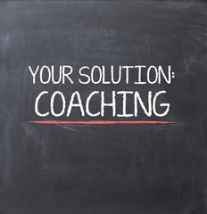 Coaching concept on blackboard