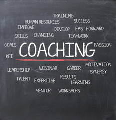Coaching concept on blackboard