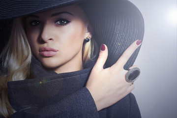 Beautiful Blond Woman in Hat. Fashionable Lady in Topcoat