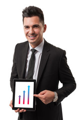 Modern business man showing the profit increase on his tablet
