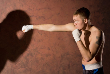 Young boxer punching his opponent