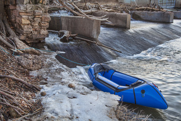 packraft and river dam