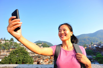 woman tourist taking photo with smart phone