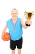 Mature basketball player holding a trophy