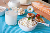 Breakfast with cottage cheese, glass of milk, bulgarian cheese