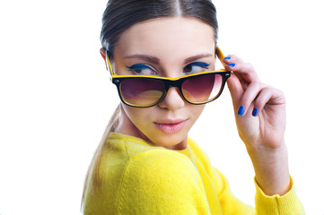 Beautiful woman with stylish colorful make up in sunglasses