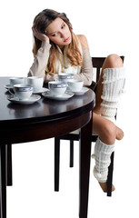 Beautiful young woman with plenty of coffee cups