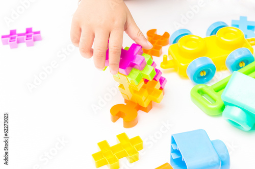 Baby hand playing block toy